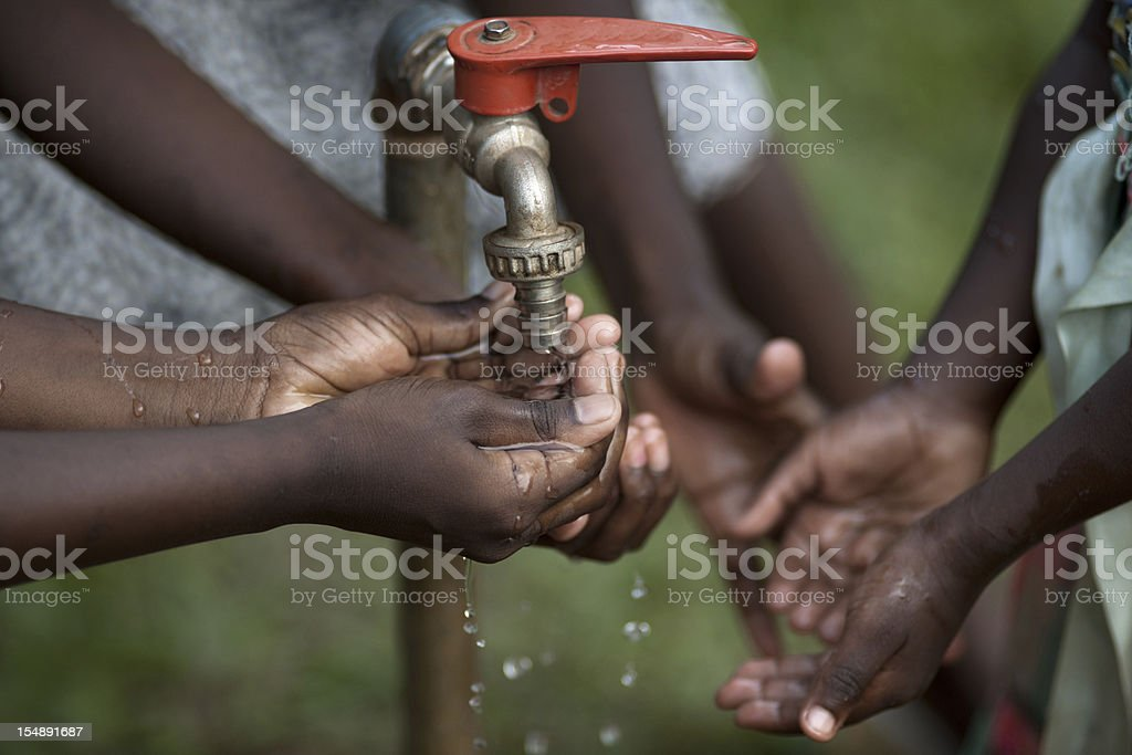 Hands of a african child under tab royalty-free stock photo