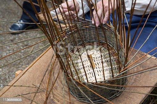 Hands of a basket maker at work