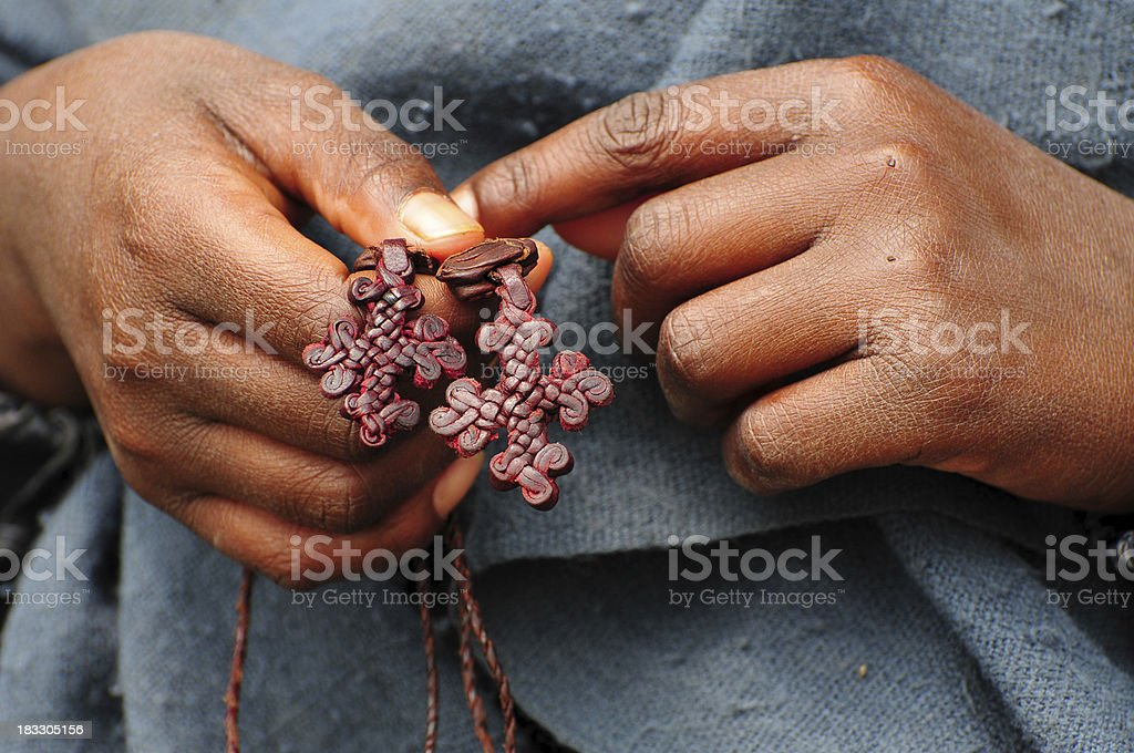 Boy holding leather crosses in Lalibela, Ethiopia stock photo