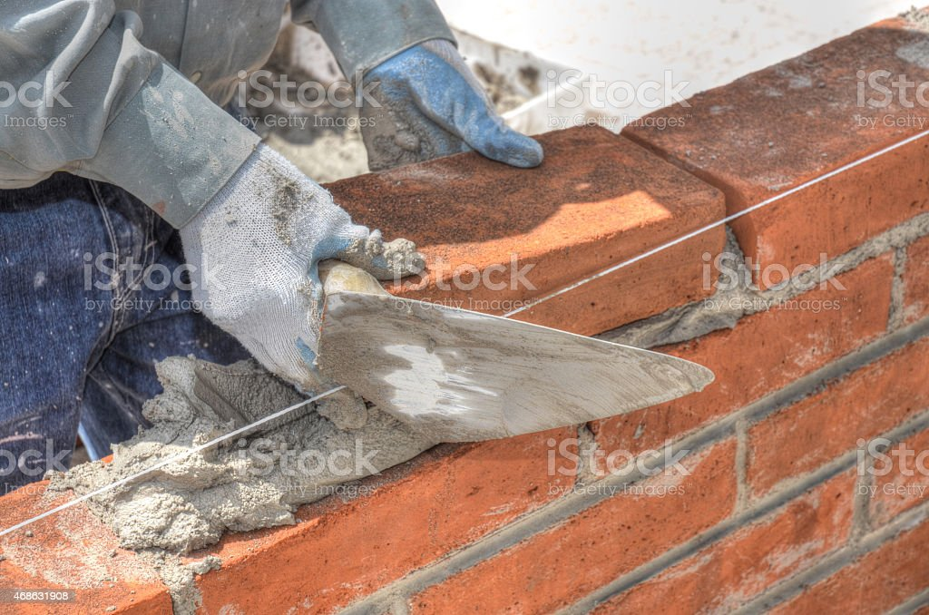 Hands of a Brick Layer stock photo