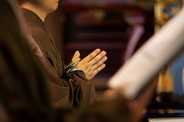 Hands of a Buddhist monk praying stock photo