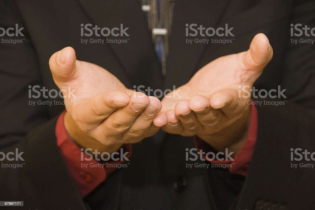Hands of a businessman offering something royalty free stockfoto