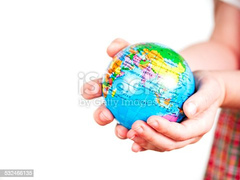 Hands of a child holding a globe on white background