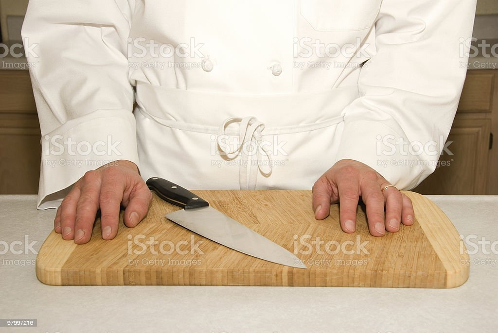 Hands of a cook on the cutting board royalty-free stock photo