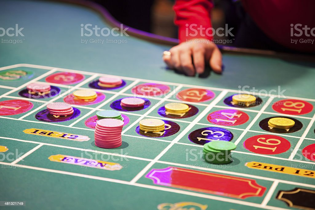 Hands of a dealer waiting at the roulette table royalty-free stock photo