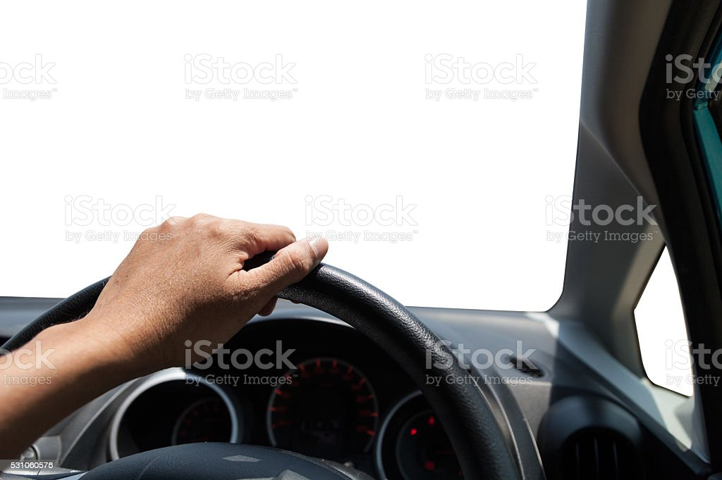 Hands of a driver on steering wheel of car stock photo