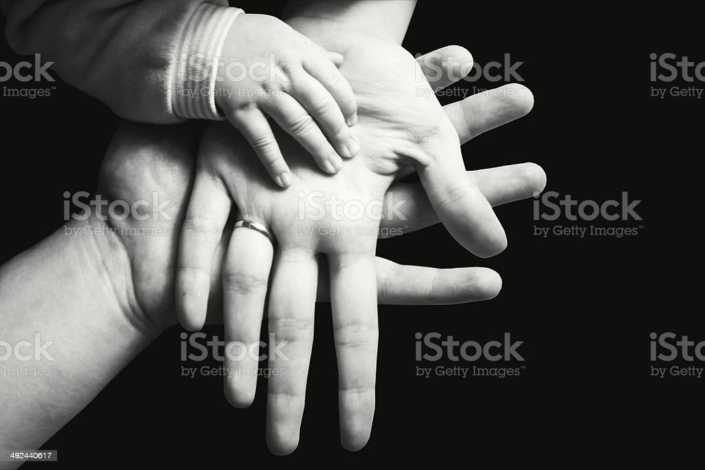 Hands of a family black and white royalty-free stock photo