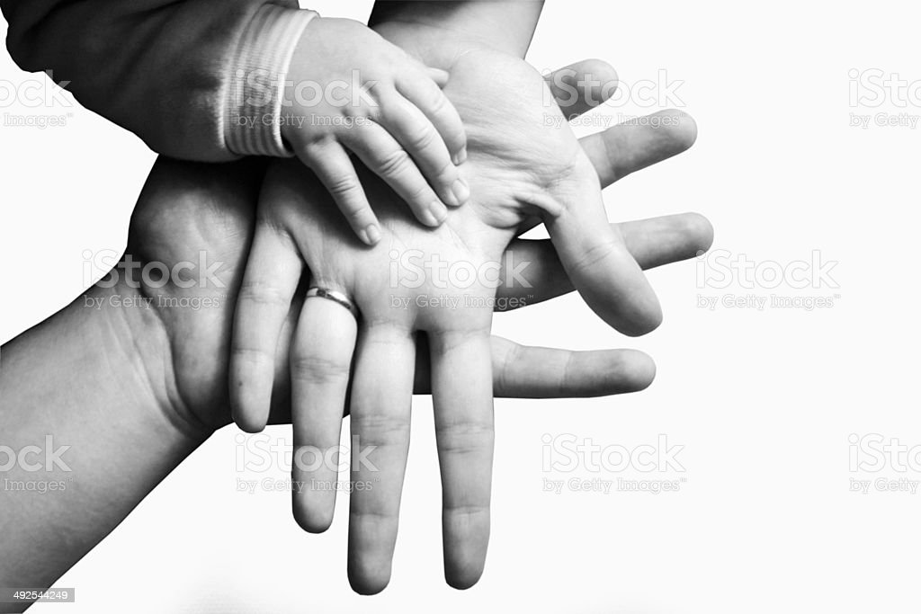 Hands of a family black and white stock photo
