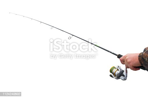 864720746 istock photo Hands of a fisherman with a spinning rod with the line and spinning reel isolated on white background 1124240502