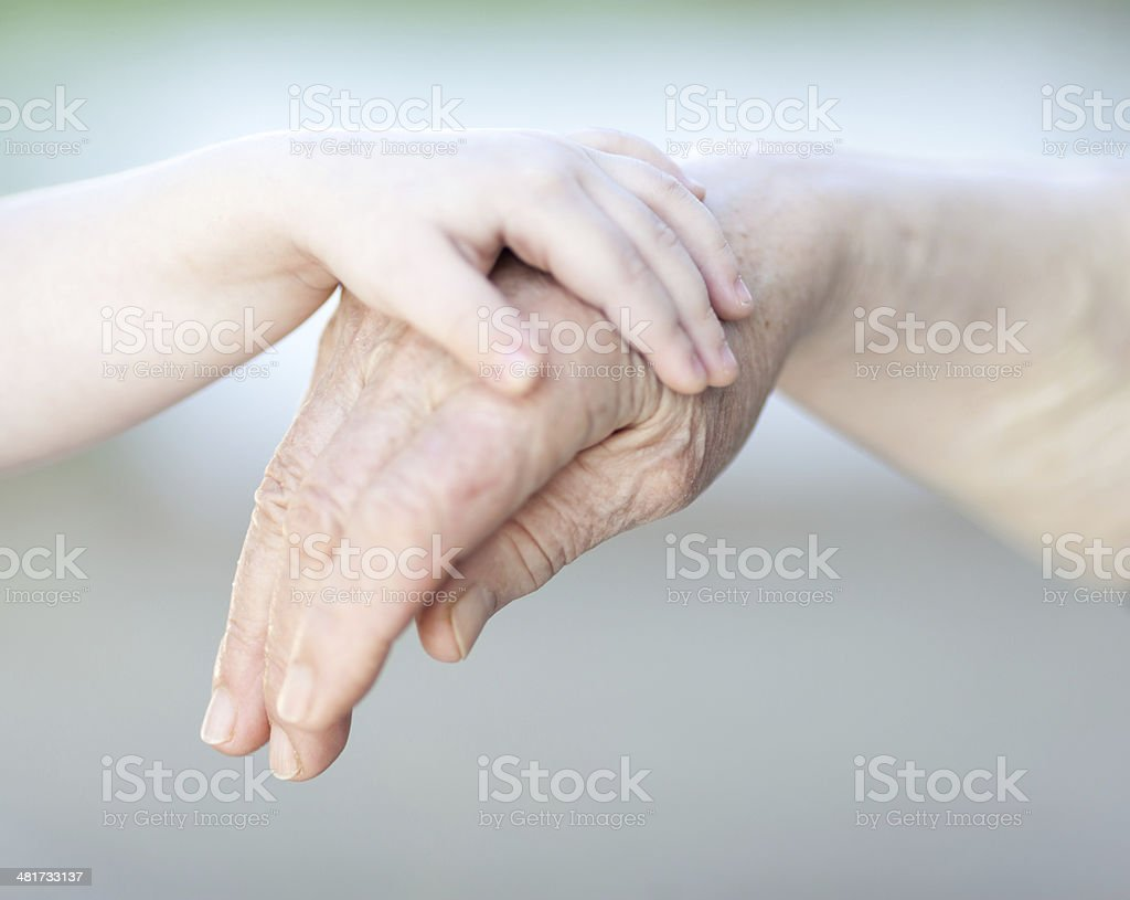hands of a grandmother and child royalty-free stock photo