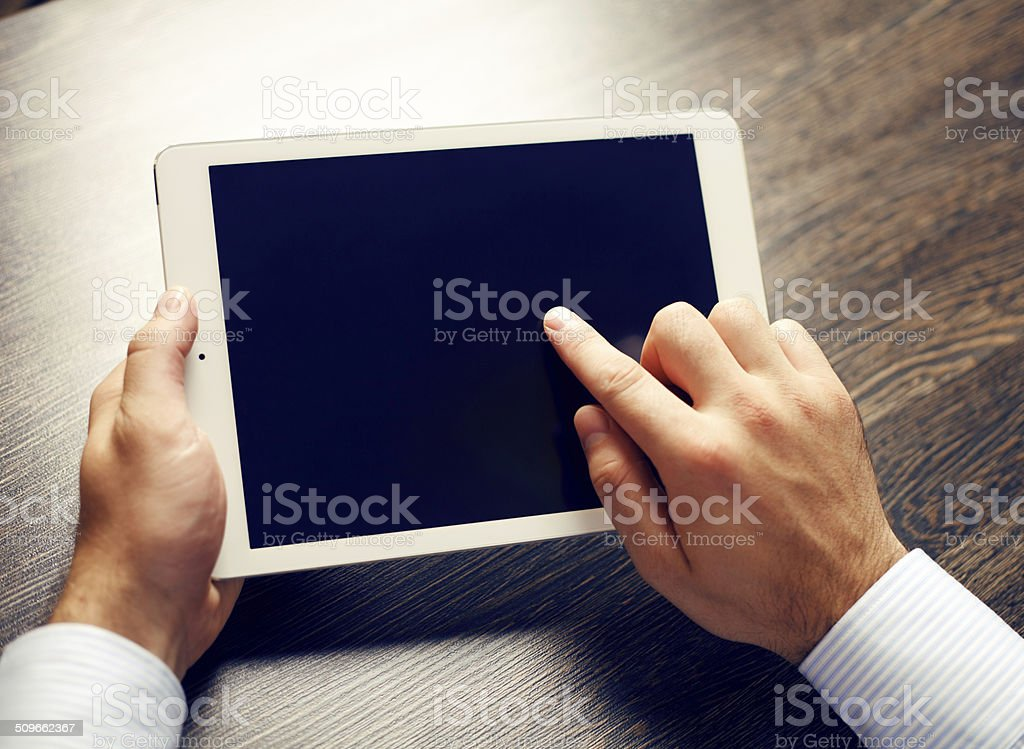 hands of a man holding blank tablet device stock photo