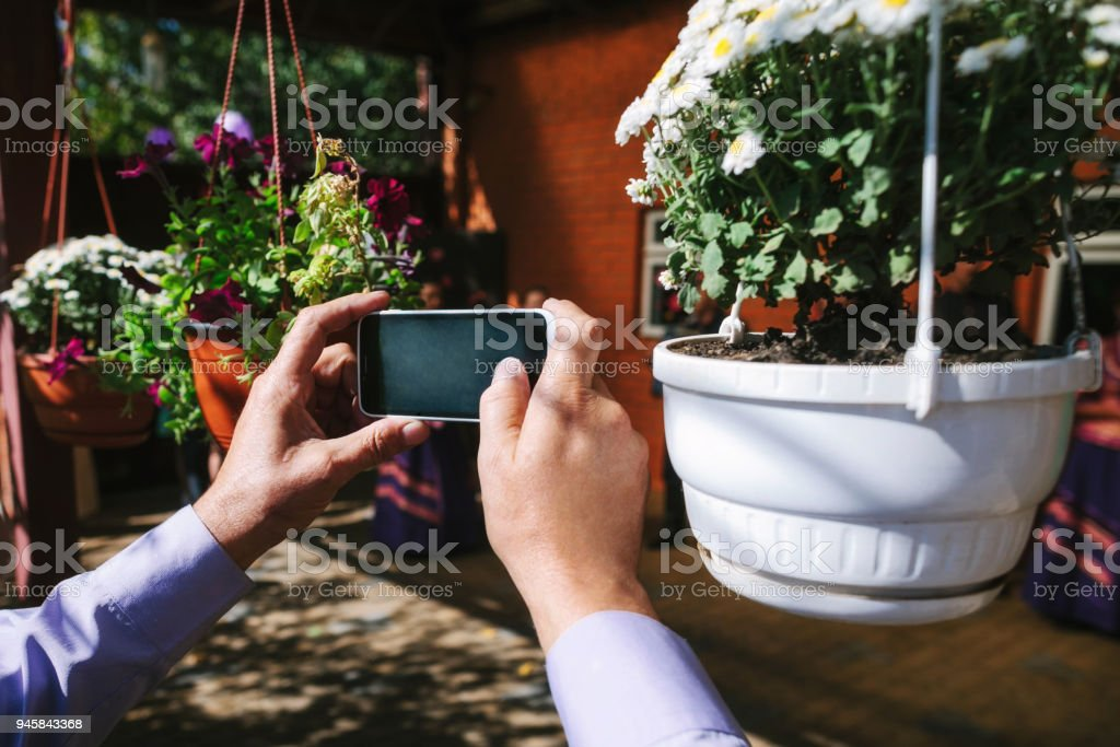 Hands of a man photographing stock photo