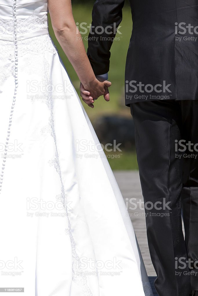 hands of a married couple on wedding day royalty-free stock photo