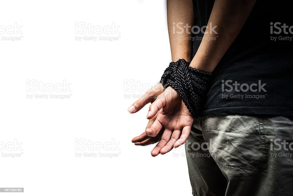 Hands of a missing kidnapped, abused, hostage, victim woman tied stock photo