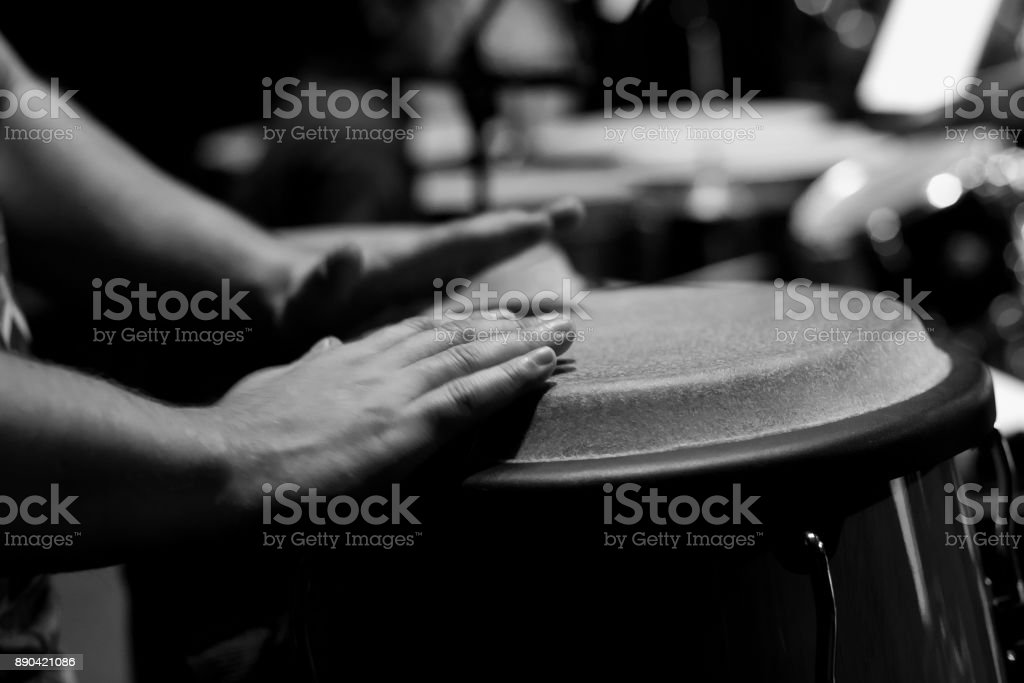 Hands of a musician playing on bongs stock photo