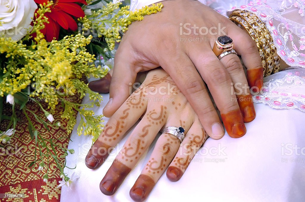 Hands of a newlywed stock photo