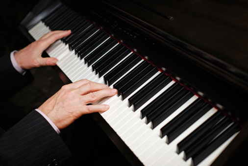 Hands of a pianist playing the piano