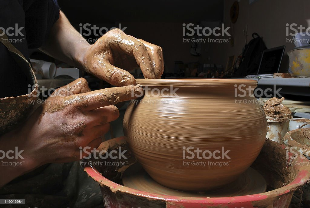 hands of a potter, creating an earthen jar - Royalty-free Adult Stock Photo