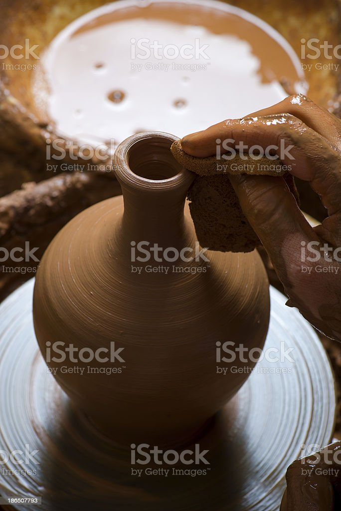 hands of a potter, creating an earthen jar royalty-free stock photo