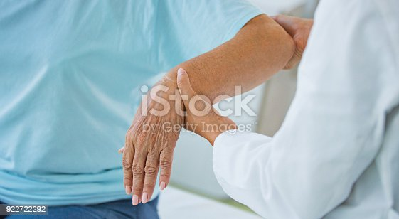 istock Hands of a senior woman at doctor's office. 922722292