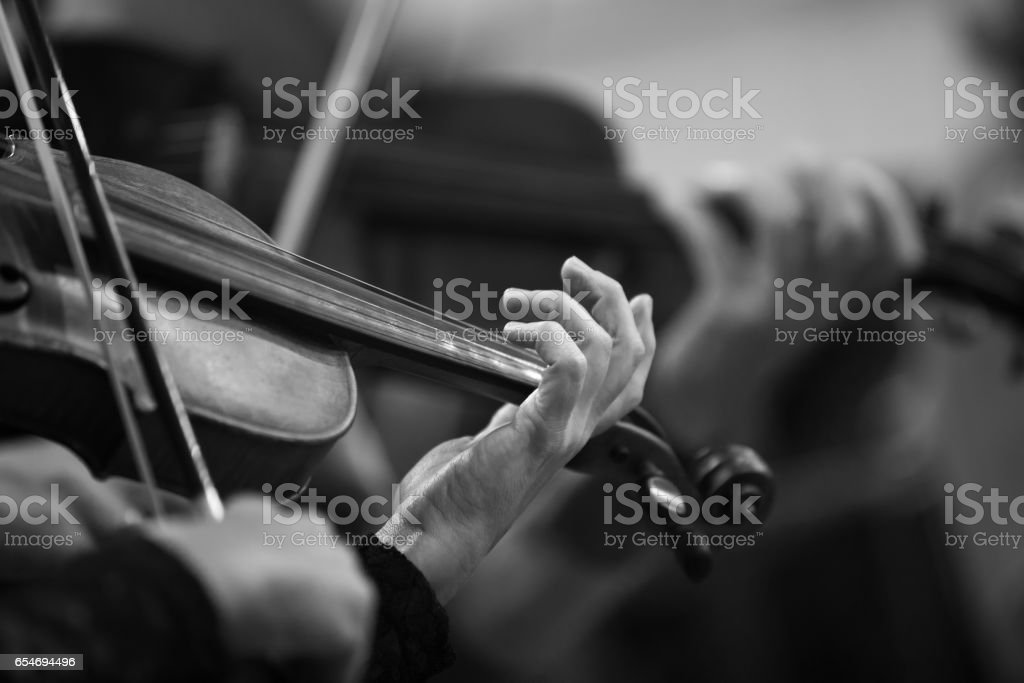 Hands of a violinist in the orchestra stock photo