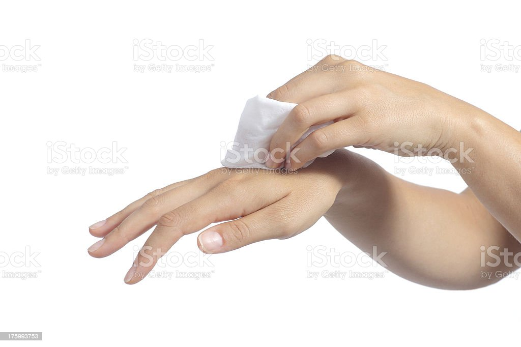 Hands of a woman cleaning with baby wipe stock photo