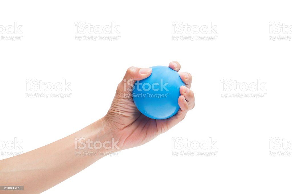 Hands of a woman holding a stress ball stock photo