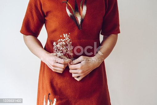 Hands of a woman holding delicate flowers.Closeup