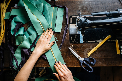 Hands Of A Woman Sewing Fabrics Stock Photo - Download Image Now