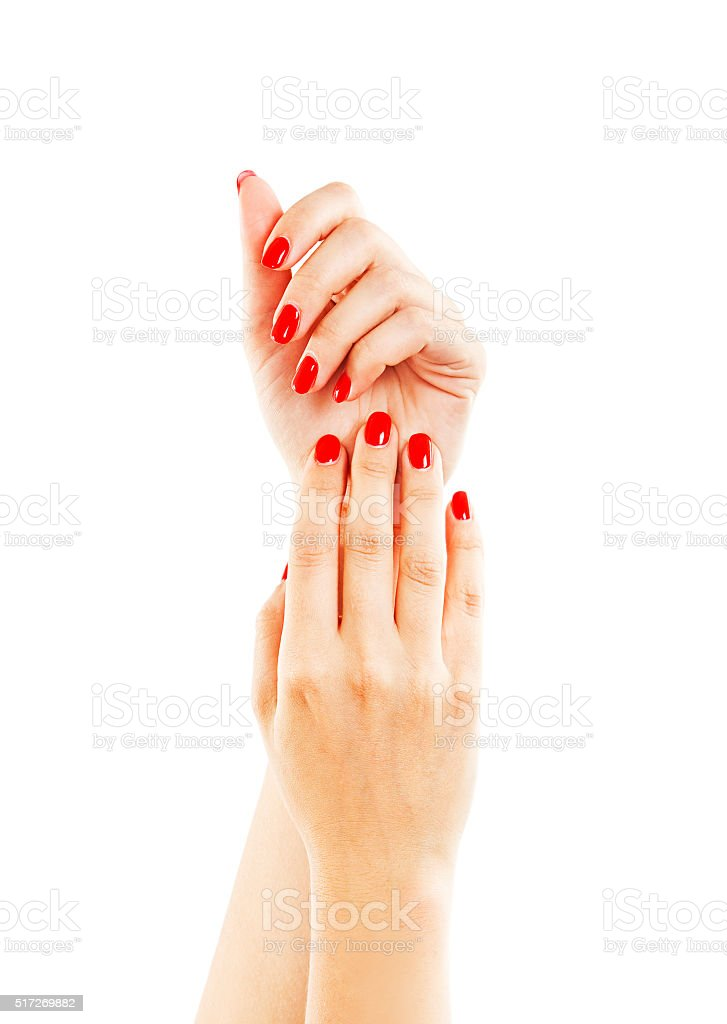 Hands of a woman with long red manicure on nails stock photo