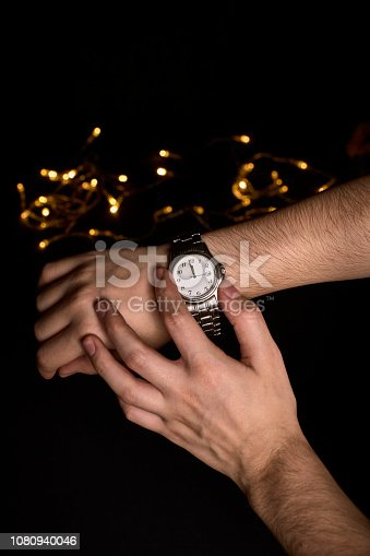 istock hands of a young person looking at a clock about to mark the first second of the new year 2019 1080940046