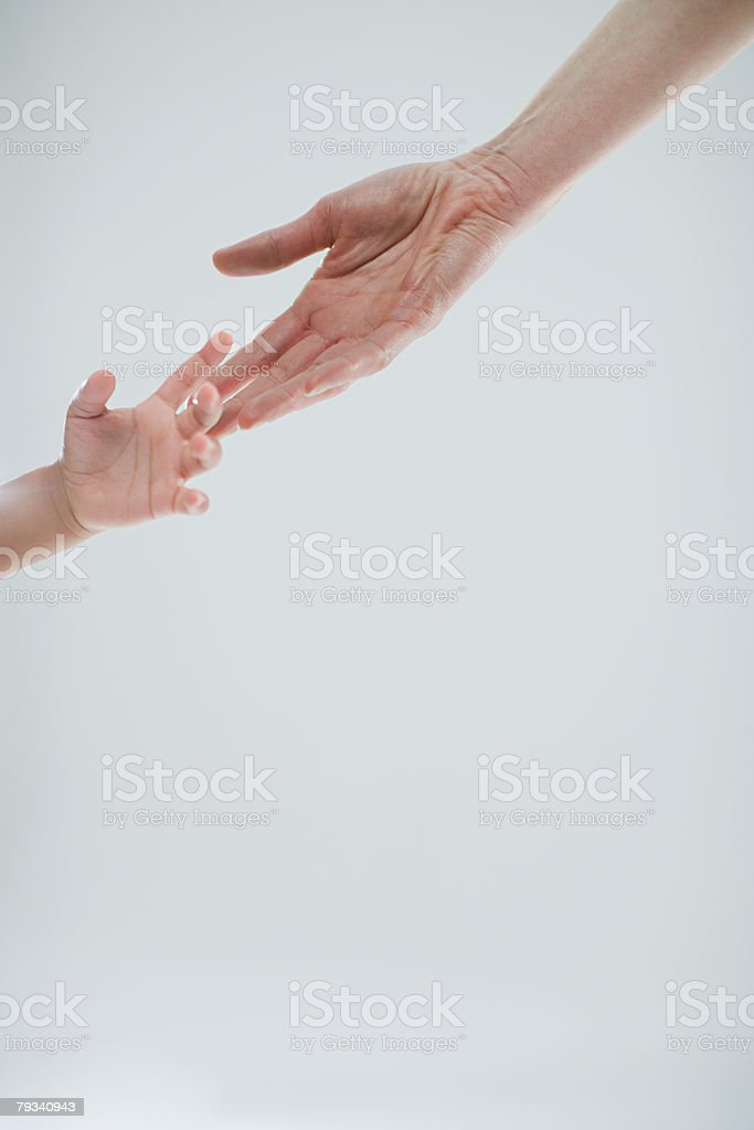 Hands of adult and child royalty-free stock photo