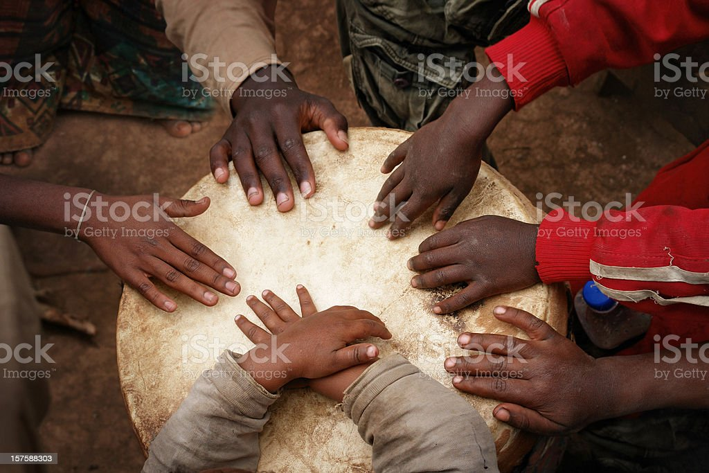 Hands of African Children Playing the Big Drum stock photo