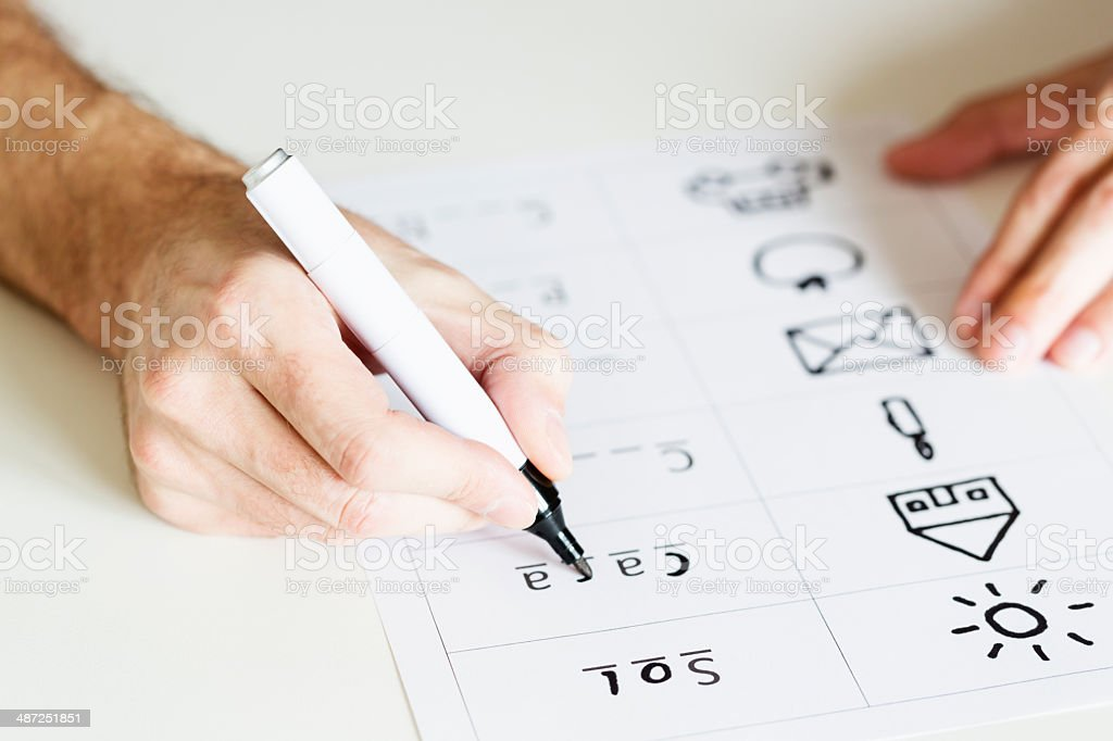 Hands of an illiterate man learning to write stock photo