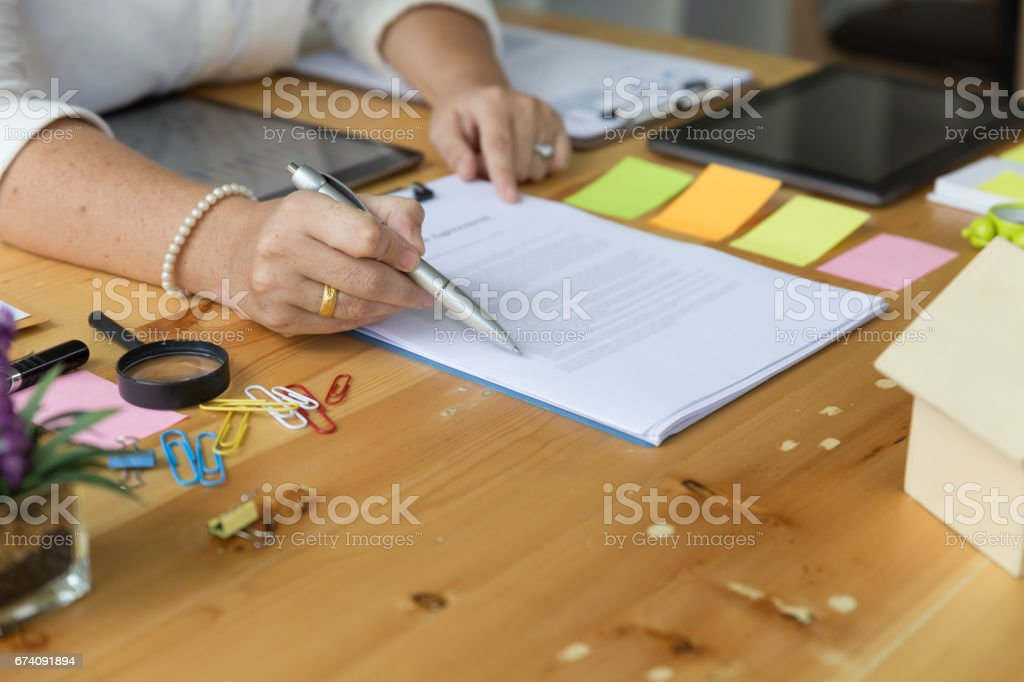 hands of an insurer or real estate agent showing mortgage loan agreement contract documents. Concept of home protection, family, insurance,rent house royalty-free stock photo