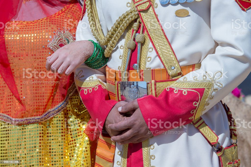 Hands of an man and a woman decorated for an indian wedding . Jaisalmer, India. stock photo