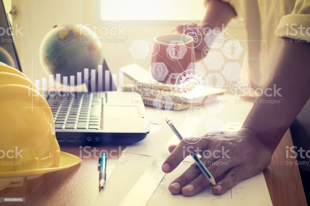 Hands of architect holding coffee cup and working in office. stock photo