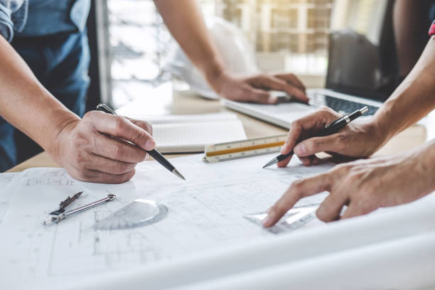 Hands of architect or engineer working on blueprint meeting for project working with partner on model building and engineering tools in working site, Construction and structure concept Hands of architect or engineer working on blueprint meeting for project working with partner on model building and engineering tools in working site, Construction and structure concept. blueprint stock pictures, royalty-free photos & images