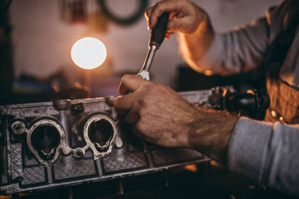Hands of auto mechanic Hands of car mechanic repairing car socket wrench stock pictures, royalty-free photos & images