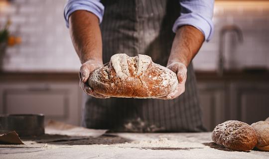 istock hands of baker's male knead dough 1025971266