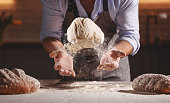 istock hands of baker's male knead dough 1025971386