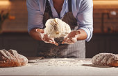 istock hands of baker's male knead dough 958433540