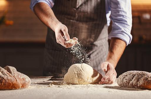 istock hands of baker's male knead dough 958433790