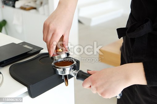 istock Hands of barista making coffee. 1155662670