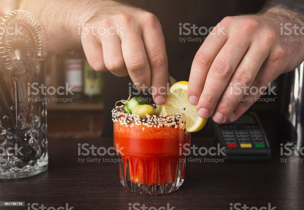 Hands of barman preparing cocktail at bar counter royalty-free stock photo