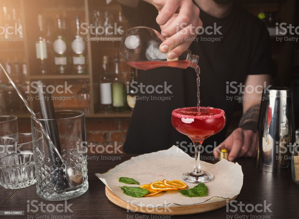 Hands of barman preparing cocktail at bar counter royalty-free stock photo
