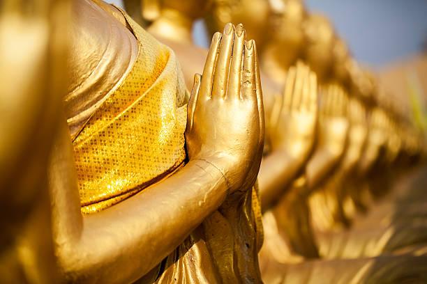 hands of buddha statue - lotus zeichnung stock-fotos und bilder