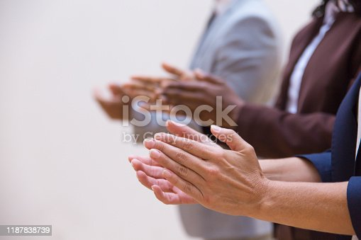 Hands of business colleagues applauding speaker. Business group appreciating presentation, seminar, training or conference. Applause or success concept