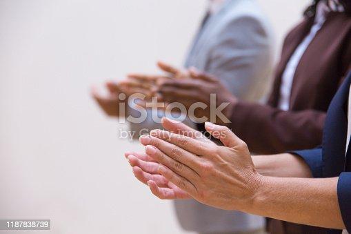 1042372612 istock photo Hands of business colleagues applauding speaker 1187838739