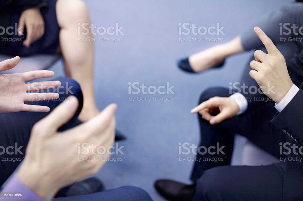 Hands of business people interacting in office meeting - foto de stock